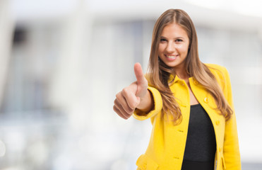 Woman giving thumbs up. Focus on the thumb