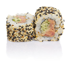 Sushi roll with sesame on a bamboo gete isolated