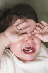 Close up of Hispanic baby crying