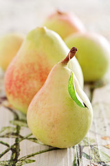 Ripe pears on a beautiful wooden table .