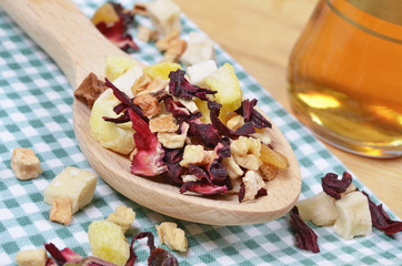 dried fruit tea, wooden spoon on a cotton tablecloth