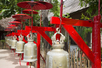 Row of bells decorated with red umbrellas