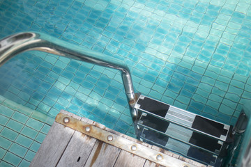 Blue swimming pool with clear water and stairs