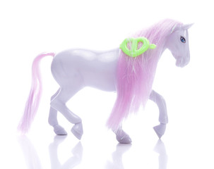 Little pony with pink mane isolated on white