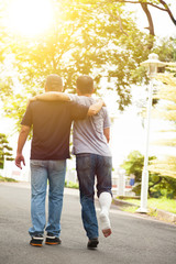 friend helping brothers or patient  to walk on the road