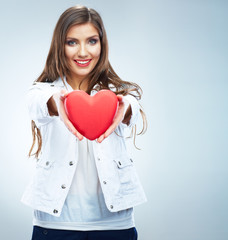 Red heart. Love symbol. Portrait of beautiful woman hold Valenti