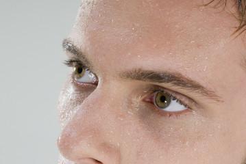 Close up of man's wet face