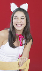 Hispanic girl wearing rabbit ears