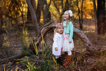 two little fashion girl in the autumn park