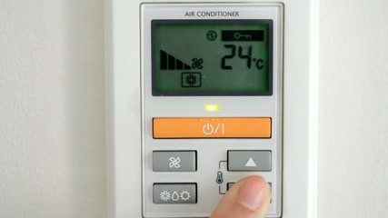 digital thermostat with finger pressing button