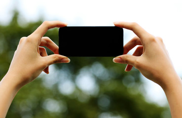 Closeup portrait of a female hands holding smartphone