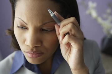 African businesswoman thinking