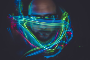 design effect lightpainting man with sunglasses and colored ligh