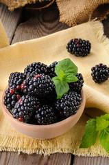 Blackberries in the wooden bowl