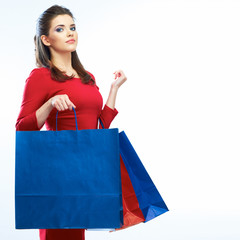 Shopping woman hold bags, portrait isolated. White background.