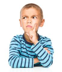 Portrait of a suspicious little boy