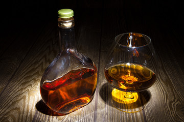 Bottle with a glass of brandy