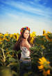 Beautiful young woman at sunflower field