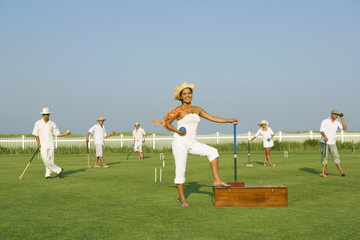Multi-ethnic friends playing croquet