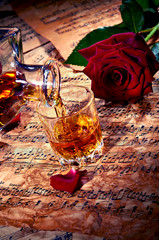 Cognac with red rose