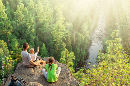 Family of backpackers look at beautiful view - 68416940