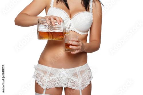 Woman pour whiskey
