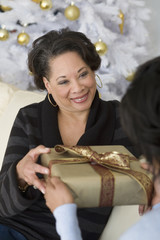 African mother receiving gift from adult daughter