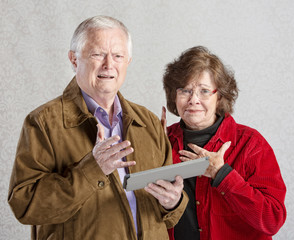 Perplexed Couple with Tablet