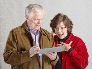 Shocked Couple with Tablet