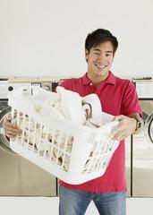Asian man in laundromat