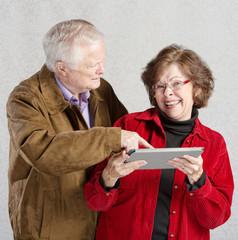 Man Looking at Woman's Tablet