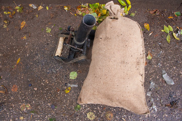 old mortar behind bag