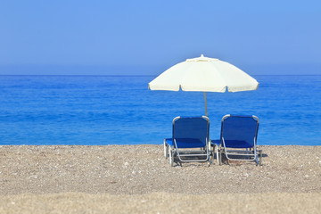 Sandy beach with parasol and two sunbeds, Gialos Lefkada