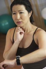 Asian woman checking pulse