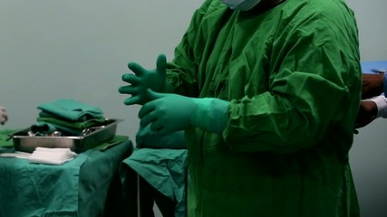 surgeon wearing protective gloves
