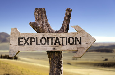 Exploitation wooden sign with a desert background