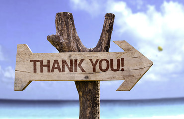 Thank You! wooden sign with a beach on background