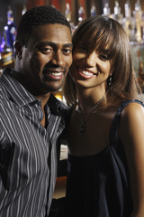 Portrait of African couple at bar