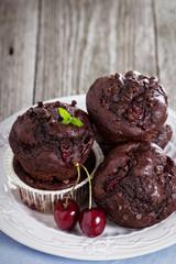 Chocolate muffins with cherry