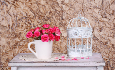 Beautiful still life with small pink roses