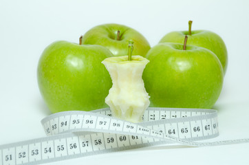 Green apples with centimeter