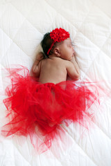 Baby ballerina. Black newborn sleeping