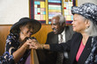 African American senior talking in church
