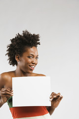 African American woman holding blank sign