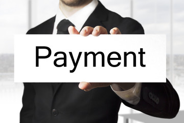 businessman holding sign payment
