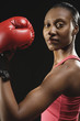 African American woman wearing boxing glove