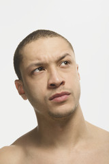 Mixed Race man looking skeptical