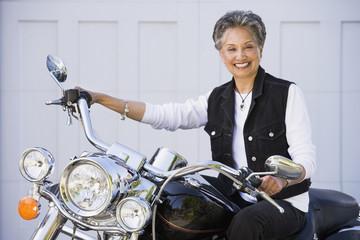 Senior African American woman sitting on motorcycle