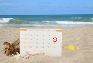 Sea shells and valentines  calendor  on white sand beach backgro