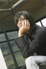Hispanic man with chin in hand